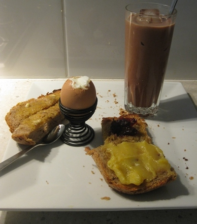 plated,boiled,egg,with,fingers,and,jam,toast